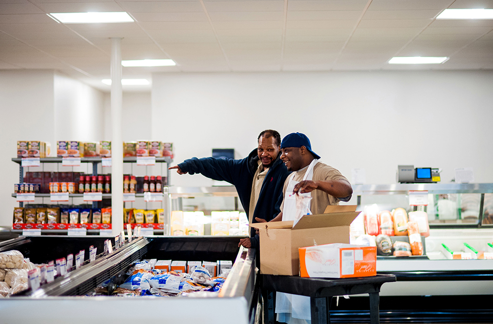 "Scott Meats, Inc. customer Jeffrey Fox II, left, asks for some help from employee, Antwan Jones, right, Thursday morning. Jones has worked at Scott Meats for over 10 years. He said he loves his job because of the customers. ""I know them by face and by name."